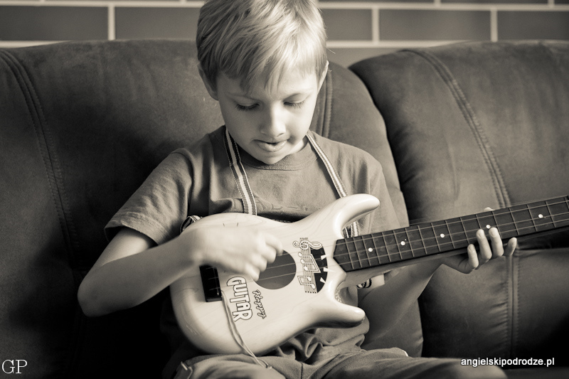 He adores playing the guitar.